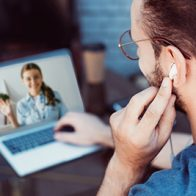 a man video chats with a woman on a computer